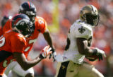 Reggie Bush runs away from pursuit for a touchdown in the second quarter of the Denver Broncos...