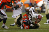 DM1820  Denver Broncos linebacker D.J. Williams #55 drags down New Orleans Saints running back...