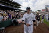 #2 Troy Tulowitzki (cq) walks around the field after the Colorado Rockies lost the last game of...