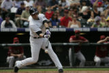 #2 Troy Tulowitzki (cq) swings at a ball as the Colorado Rockies lose the last game of the regular...