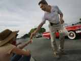 Scott Starin campaigns at a parade handing out leaflets  'Lafayette Days' in Lafayette, Colo....