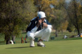 john vandelinder/daily press  Wyndham Clark, a Valor Christian freshman, eyes his putt on the 18th...
