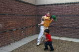 MJM128   Lori Martin (cq) carries her daughter, Joscelyn Martin, 6, as fellow prisoner's son,...