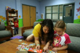 MJM309   Gina Trujillo (cq) plays with fellow prisoner's daughter, Joscelyn Martin, 6, Friday...