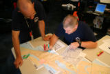 Plan team managers Kevin Schmidt (cq) and Clay Steward (cq) look at the area they were assigned to...