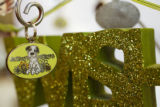 Dog tags are sold for proceeds to help cure canine cancer at Zen Dog on Sept. 16, 2008, when Eat!...