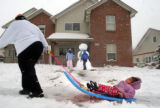 01/05/2005)Denver-Denver firefighter Lt. Robert Miller, Station 23, warms a dog with a blanket and...