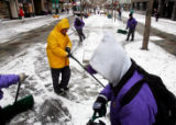 01/05/2005)Denver-Bruce Babcock, Arvada, a volunteer for the Red Cross, walks along Speer...