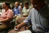 Terry Erwin (cq) votes during an RTD meeting discussing future plans for Fastracks at RTD main...