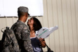 (PG8432) Spc. Servando Gomez (cq) and his girlfriend Yesenia Diaz (cq) share a moment after a...