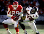 (KANSAS CITY, Mo., SHOT 12/19/2004) The Denver Broncos' D.J. Williams (#52, LB) tries to wrestle a...