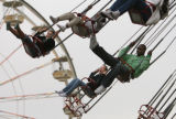 MJM073  Broncos receiver, Brandon Marshall, right, rides an amusement park ride with children from...