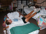 "Long distance runner Anita Fromm lies on bed. This is an explanation from Anita:  ""The photo..."