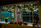 Arielle Williamson, 8, (cq) hangs a decoration inside her families sukkah. The holiday celebrates...