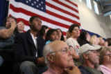 (at center front row) James T. Watson, a WWII veteran waits for Senator Obama to enter the...