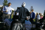 Dozens of people purchase Senator Obama paraphernalia, as they wait in line for the Senator's...
