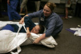 Registered nurse Shauna Kelly (cq) tries to swaddle another Exempla St. Joseph's Hospital...