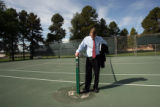 Denver Public Schools Superintendent Michael Bennet (cq) examines the tennis court at South High...