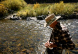 (PG9583) A fisherman (who wished not to be named) baits his hook while trout fishing in Boulder...