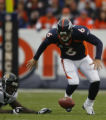 JPM191 Denver Broncos Jay Cutler watches the ball bounce away from him after his fumble against...
