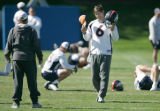 BG0080 Denver Broncos quarterback Jay Cutler #6 puts on his helmet and gets back to work after a...