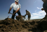 0535 Scott Wills, Elebrt County Republican chair, helps remove dirt from a babeque pit at the...