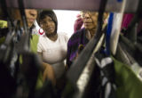 (041) Iecia Haqq, 14, of Denver, surveys the pants selection as she shops for new clothes Sunday,...