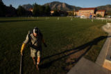 MJM007 CU employee, George Wallack (cq) uses a leaf blower to clear off Farrand Field as...