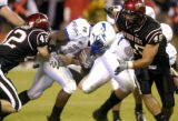 Air Force Academy tailback asher Clark (#17) center, rushed for a touchdown against San Diego...