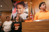 BG0141 Raymond Moreno, right, a parent of a sophomore at West High School stands with parents and...