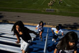 Jamie Donaldson, 34 (back left) (cq) runs with Monica Nunez, 12, (cq) (front left), Ashley...