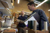 David Jessup , from Boulder, right, is helped by Eco-Products employee Dan White , left, as he ...