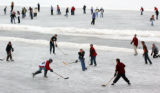 (EVERGREEN Colo., December 27, 2004) Skaters of all kinds enjoy a nice day at Evergreen Lake...