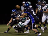 Highlands Ranch quarterback Mitch Kahl gets off a pass to Mike Jose to avoid a sack against...