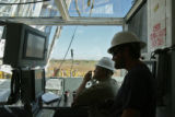 Jonathan Hunt (cq), left, and Gary Hensz (cq) man the Drillers Council, at the Milkyway Well,...