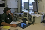 Brent Mayo (cq), is at the Frac control center of the Everist Well, Thursday morning, September 2,...