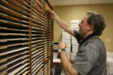 Jerry Hoover (cq), temp worker, sorts 400 ballots by style in special cabinets, Friday afternoon,...