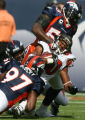 0071 Denver Broncos (97) Boss Bailey (51) Jamie Winborn and (55) D.J. Williams tackle Tampa Bay...