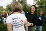 Dianna DeGette laughs as she views a t-shirt worn by Leslie Lawson  at a backyard Rally For...