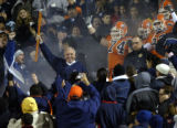 (EL PASO TIMES FILE PHOTO) University of Texas-El Paso head coach Mike Price led his Miners onto...