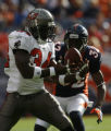 JOE0396 Denver Broncos cornerback Dre Bly (32) zeroes in on Tampa Bay Buccaneers running back...