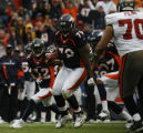 JOE0673 Denver Broncos defensive tackle Marcus Thomas runs with an ball he intercepted off Tampa...