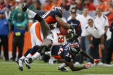 MJM631 Ike Hilliard of the Tampa Bay Buccaneers catches a pass against the Broncos Jamie Winborn,...