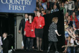 Republican VP candidate Sarah Palin, entering the hall with her daughters, Piper, right, and...