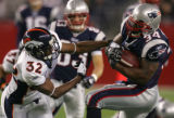 (CS023) Dre Bly tries to tackle Sammy Morris in the 2nd quarter of the Denver Broncos against the...