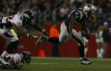 JPM216 Denver Broncos Louis Green can't catch New England Patriots running back Sammy Morris on a...