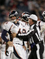 (CS190) The official steers Jay Cutler away after he was sacked in the fourth quarter of the...