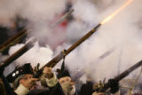 (CS206)Patriots fire their muskets at the start of the first quarter of the Denver Broncos against...