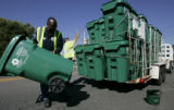 Denver Solid Waste Recycling employees Henry Hudson (cq) , left, and Michael Carabajal (cq)...