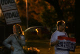 MJM062  Supporters of Mark Udall and Bob Schaffer compete for car honks as they stand in close...
